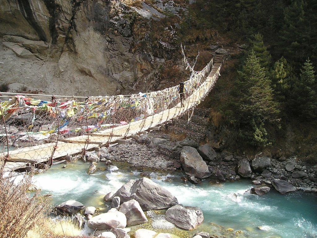 Crossing a bridge in Nepal