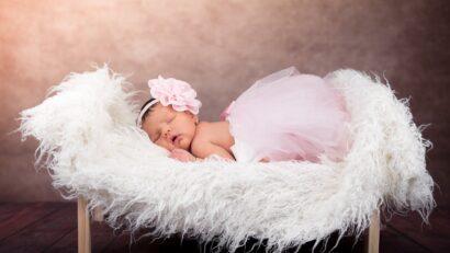 Little girl sleeping on a crib
